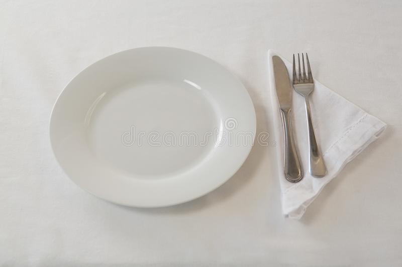 Plate, cutlery set and napkin on table vector illustration
