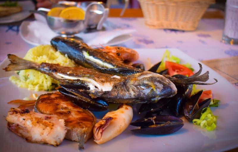 Dinner in Mediterranean seafood restaurant. stock images