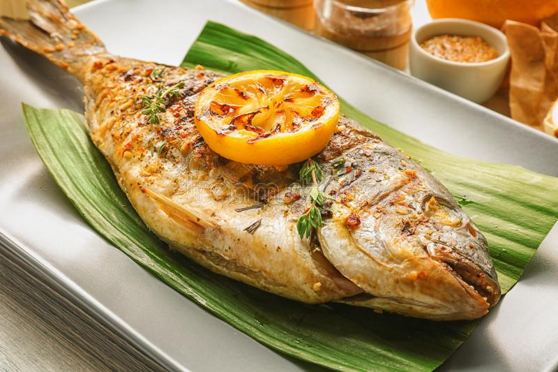 Plate with delicious fried fish. Closeup royalty free stock photos