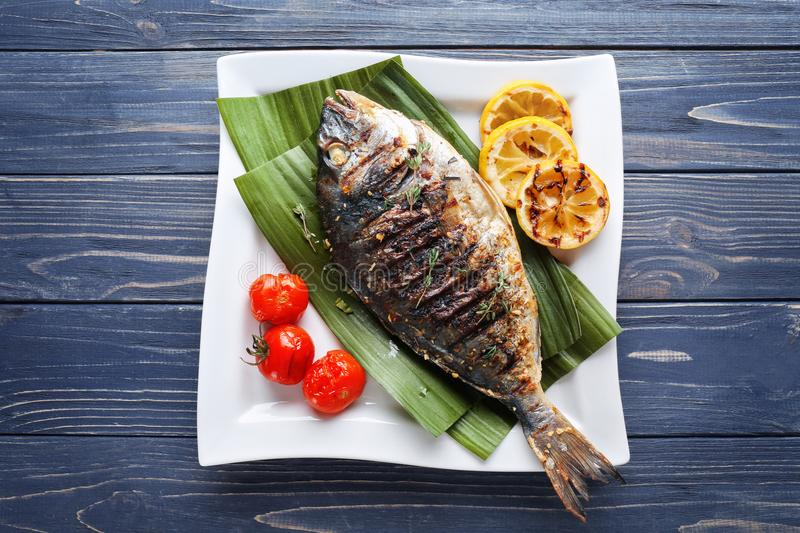 Plate with delicious fried fish royalty free stock photo