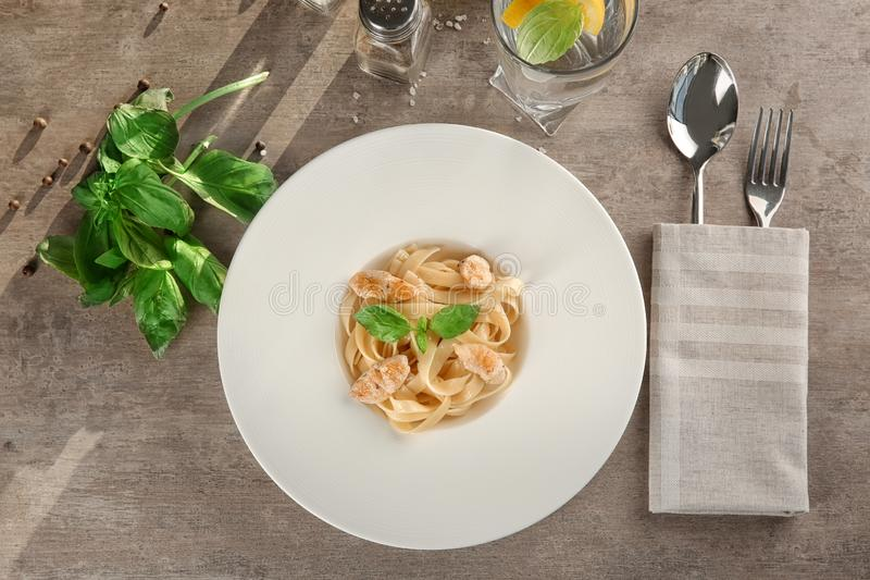 Plate of delicious pasta with chicken fillet on table, top view stock image