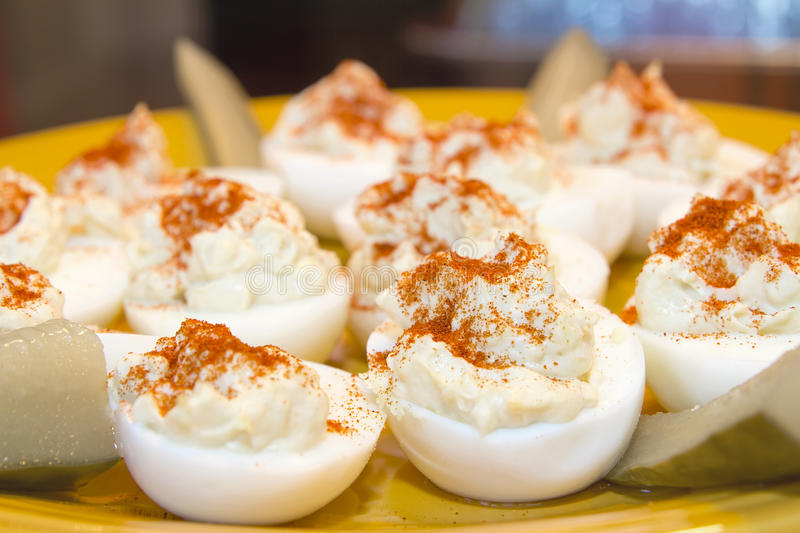 Plate of Deviled Eggs and Pickles Closeup royalty free stock images