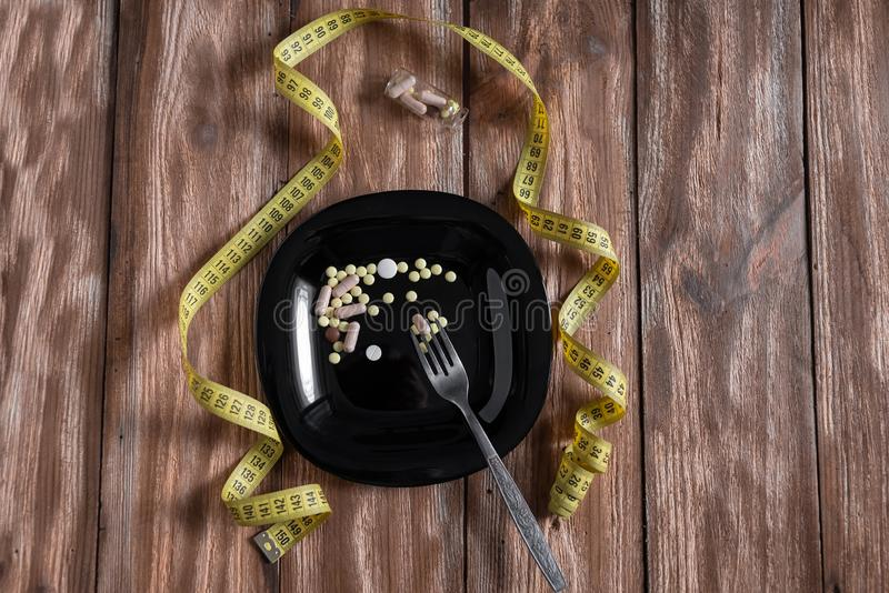 A delicious meal of diet pills on a beautiful plate stock photo