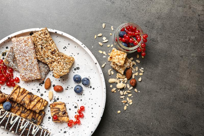 Plate with different grain cereal bars. On table, top view. Healthy snack stock images