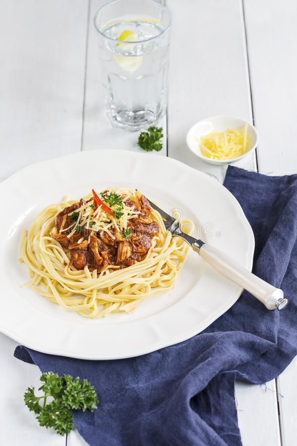 Fettuccine with stewed chicken in tomato sauce royalty free stock photos
