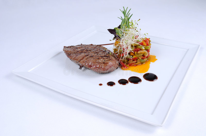 Plate of fine dining meal ostrich fillet salad