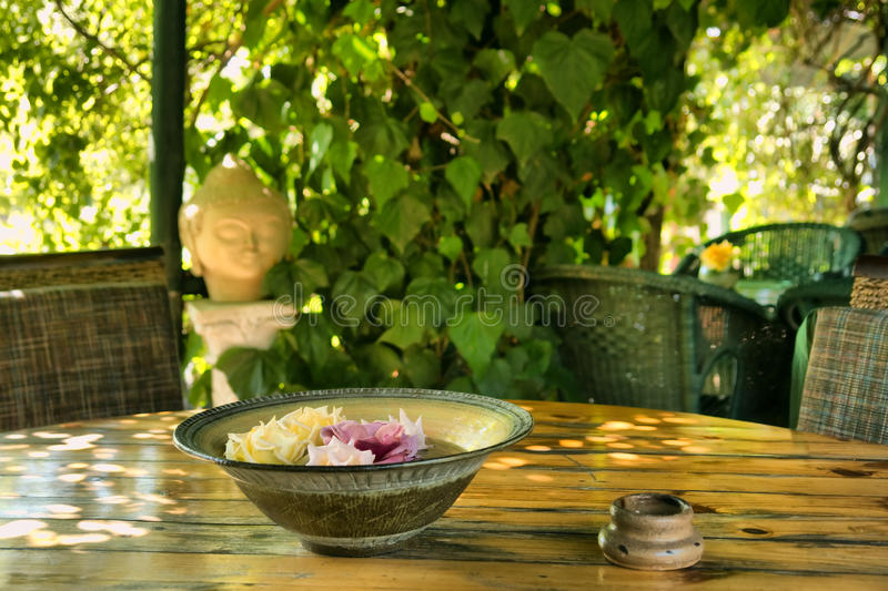 Plate with flowers in outdoor Thai restaurant stock photography