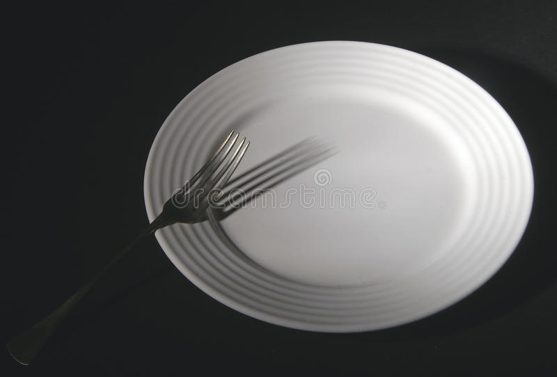 Plate and fork royalty free stock images