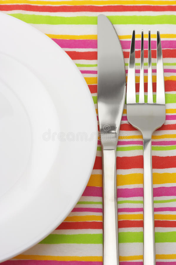 Plate, fork and knife stock images