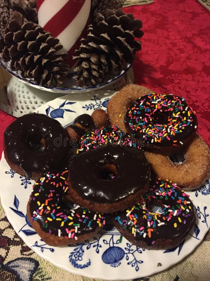 A plate of fresh baked donuts royalty free stock image