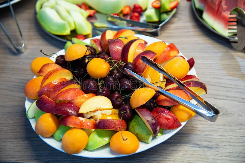 Plate with fresh fruit ready for morning breakfast. royalty free stock photography