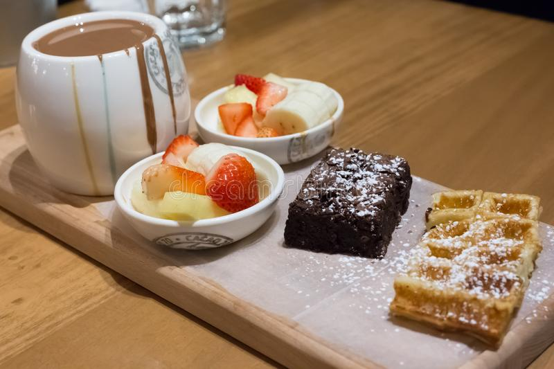 Chocolate Fondue with Fresh Fruits, Brownie and Waffle stock photography