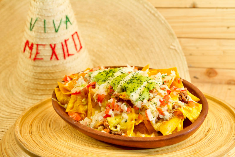 Plate Of Fresh Nachos With A Jalapeno Cheese Sauce Stock Image