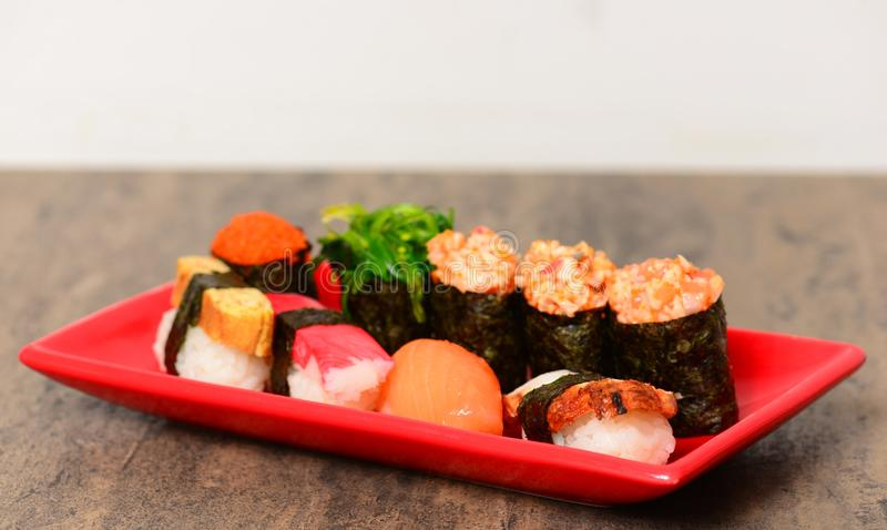 Plate with fresh sushi stock images