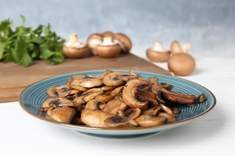Plate of fried mushrooms on table royalty free stock photo