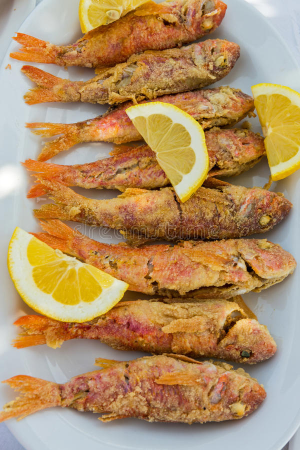 Plate of fried small fish red mullet stock photo image for Eating mullet fish