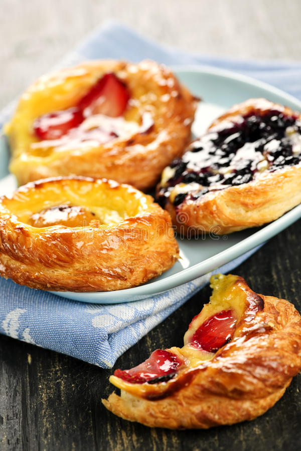 Plate of fruit danishes. Closeup of fruit danish desserts on a plate stock images