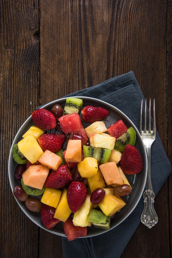 Plate full of healthy exotic fruits slices royalty free stock photography