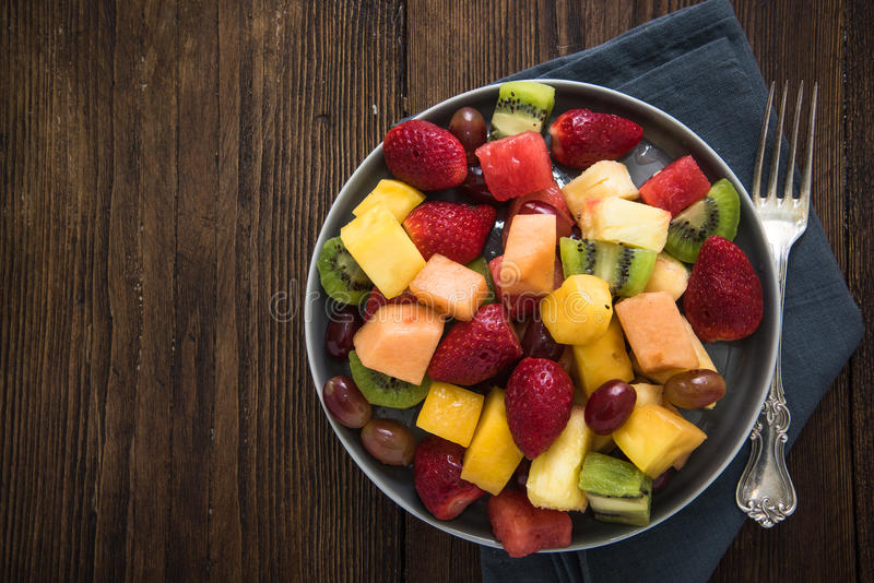Plate full of healthy exotic fruits slices stock photo