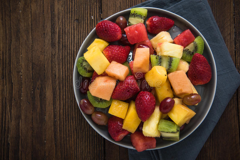 Plate full of healthy exotic fruits slices stock images