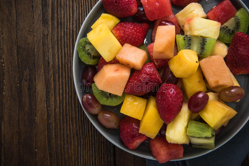 Plate full of healthy exotic fruits slices stock image