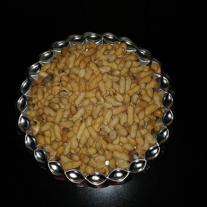 Plate full of peanuts or ground nuts or monkey nuts royalty free stock images