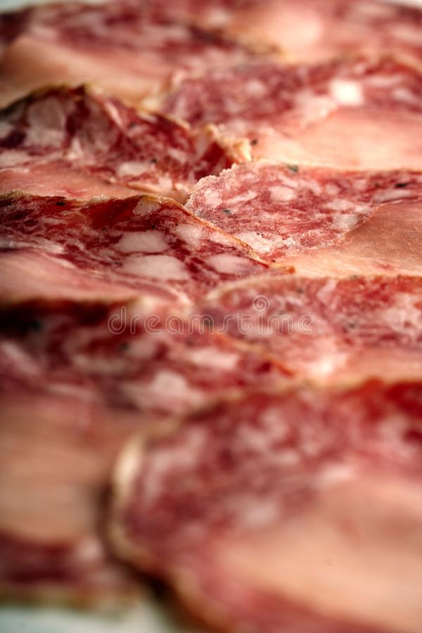 Plate of sliced salami. A plate full of sliced salami royalty free stock image