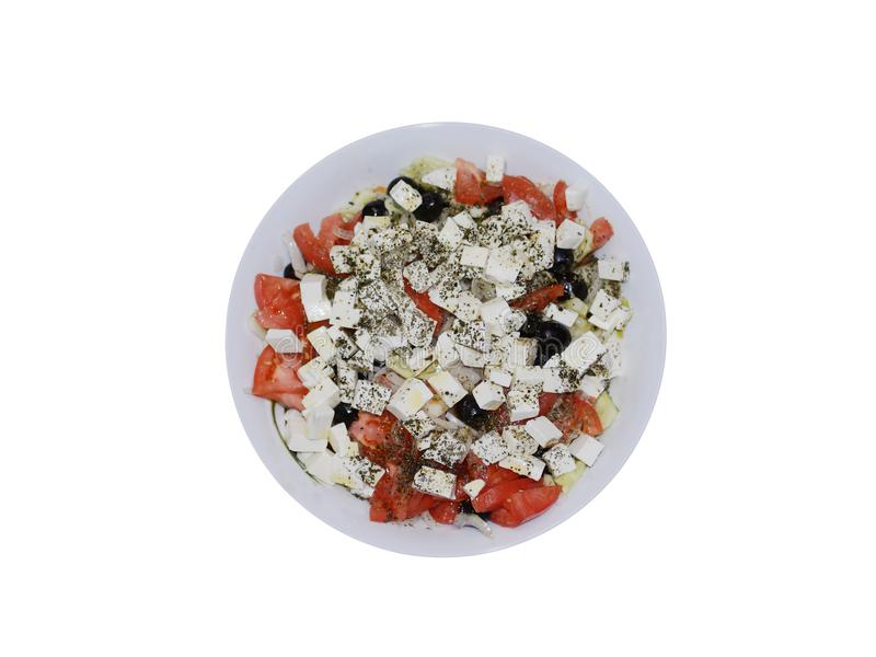 Plate with the Greek salad isolated on a white background royalty free stock photography