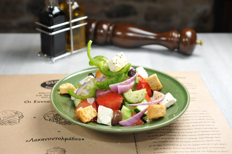 Plate with greek salad stock images