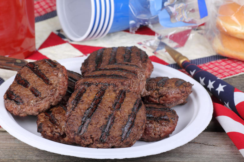 Plate of Grilled Hamburgers royalty free stock photo
