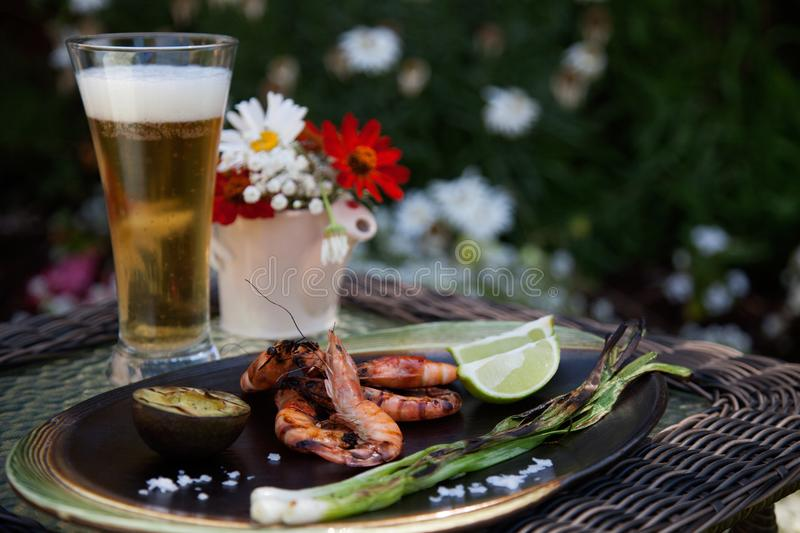 Whole Grilled Shrimps Dinner in Garden stock photos
