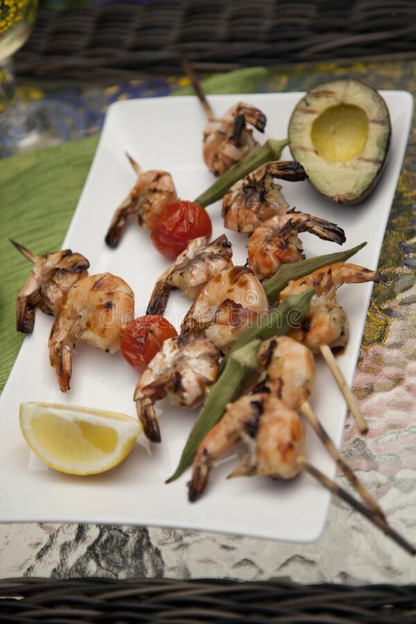 Grilled Shrimps Skewers for Dinner in Garden royalty free stock photo