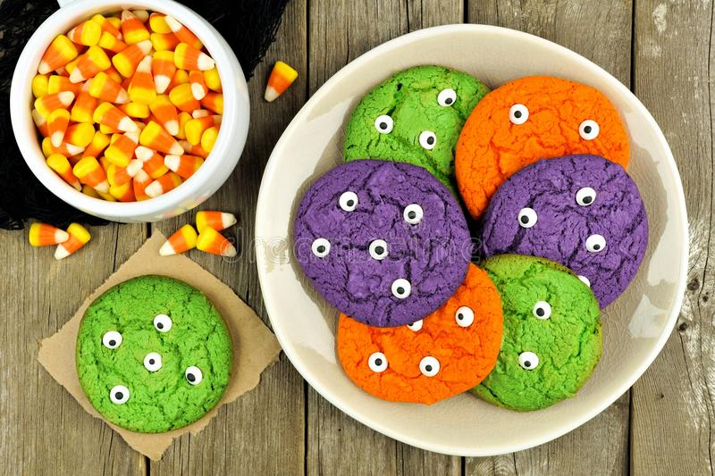 Plate of Halloween monster eyeball cookies with candy corn royalty free stock photography