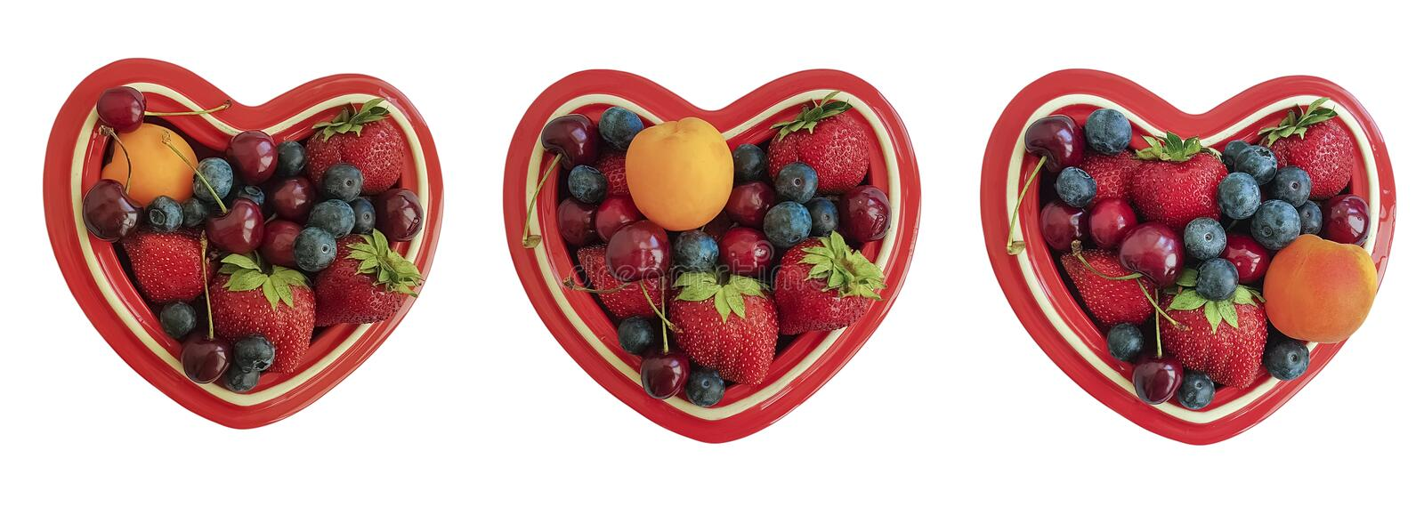 Plate heart, fruit berries, cherry, strawberry, blueberry isolated stock image