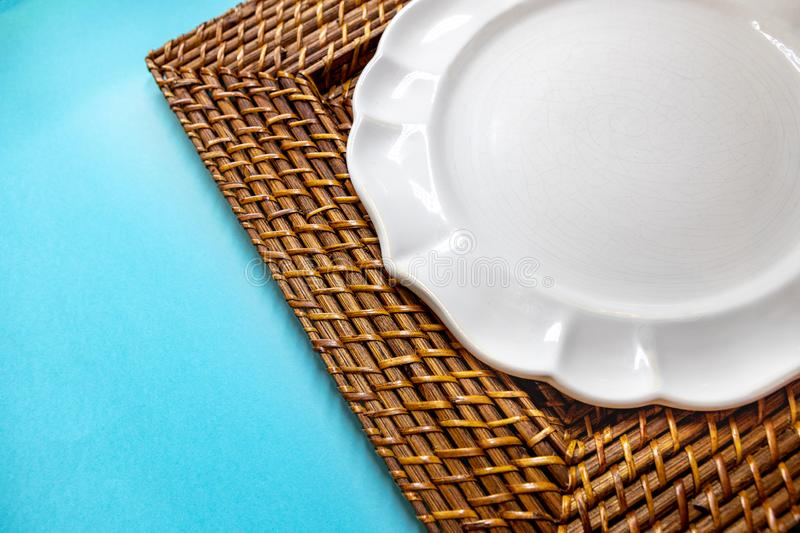 A support for plates made of straw in varnish. royalty free stock photos