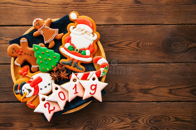 Plate with homemade gingerbread Christmas cookies, Stars with nu. Mbers 2019. Wooden backdrop. Top view and copy space royalty free stock photography