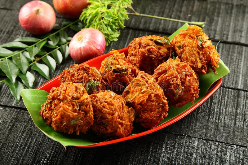 Plate of Indian strret food onion fritters. Indian street snack onion pakoda or fritters royalty free stock image
