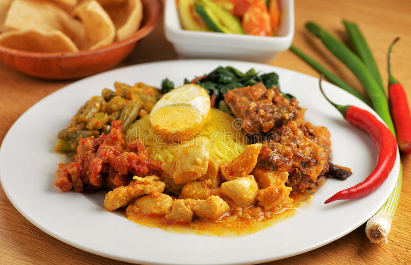 Plate of indonesian food. Various kind of indonesian food with rice stock photo
