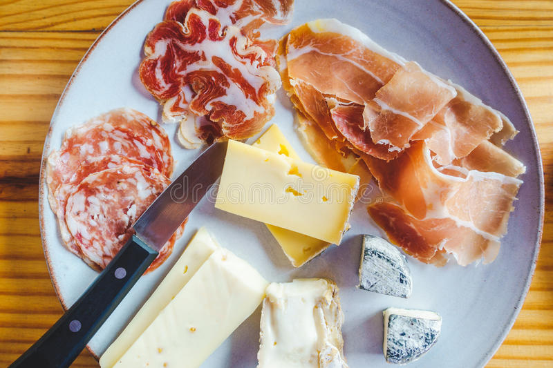 Plate of Italian cheese and charcuterie royalty free stock photo