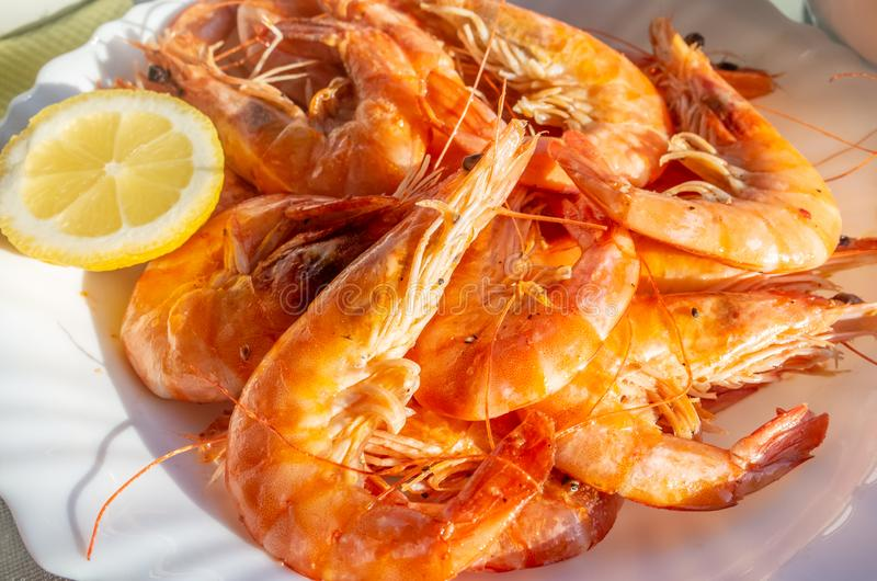 A Plate of King Prawns with Lemon. stock image