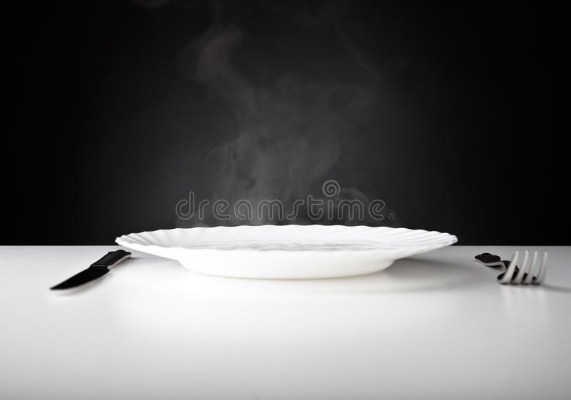 Plate, knife and fork royalty free stock photo