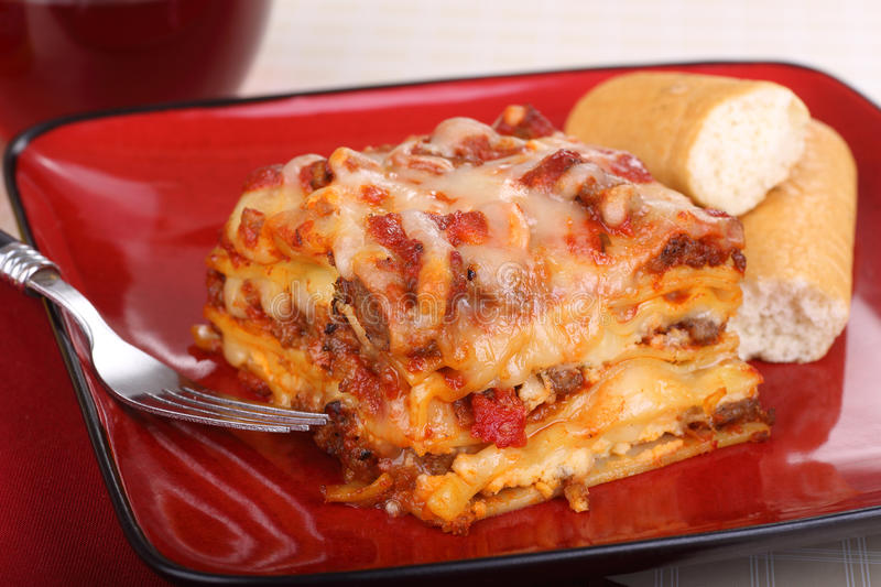 Plate of Lasagna. Slice of lasagna with bead sticks on a plate stock photos