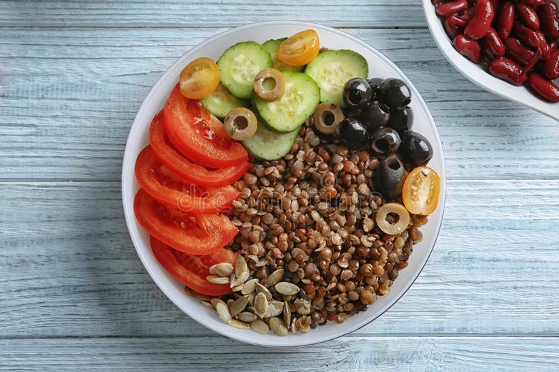 Plate with lentil porridge, olives and fresh vegetables royalty free stock photography