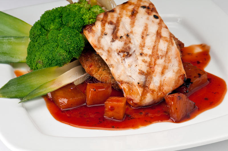 Plate of Mahi Mahi. Severd with vegetables, pineapple and soy sauce royalty free stock photography
