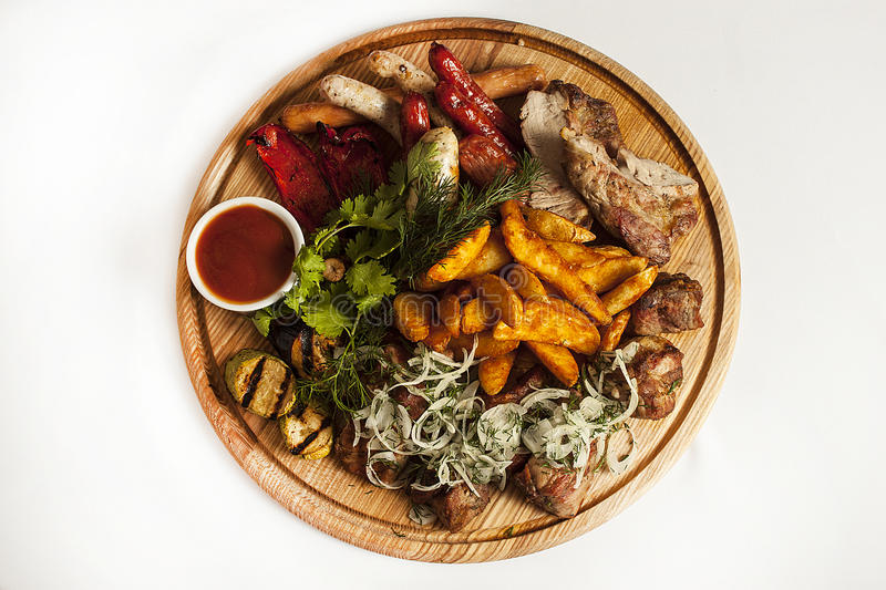 Plate with meat for beer stock image