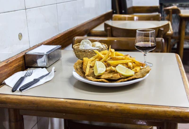 Milanesas con papas fritas & x28;schnitzel made with cow beef and fri. A plate of Milanesas con papas fritas & x28;schnitzel made with cow beef and fries stock photos