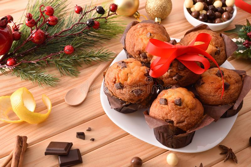 Plate with muffins on table with Christmas decoration elevated view royalty free stock image