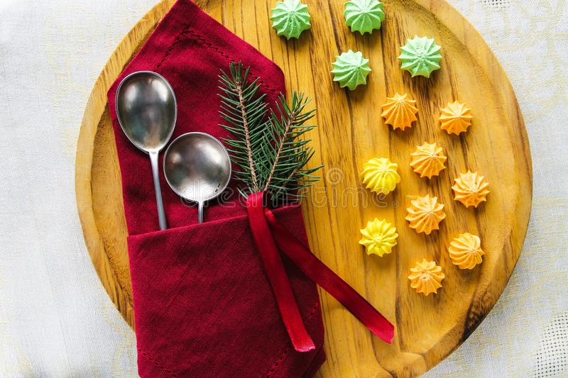 Plate, napkin, Cutlery. A sprig of spruce. Table setting. Christmas.The view from the top stock image