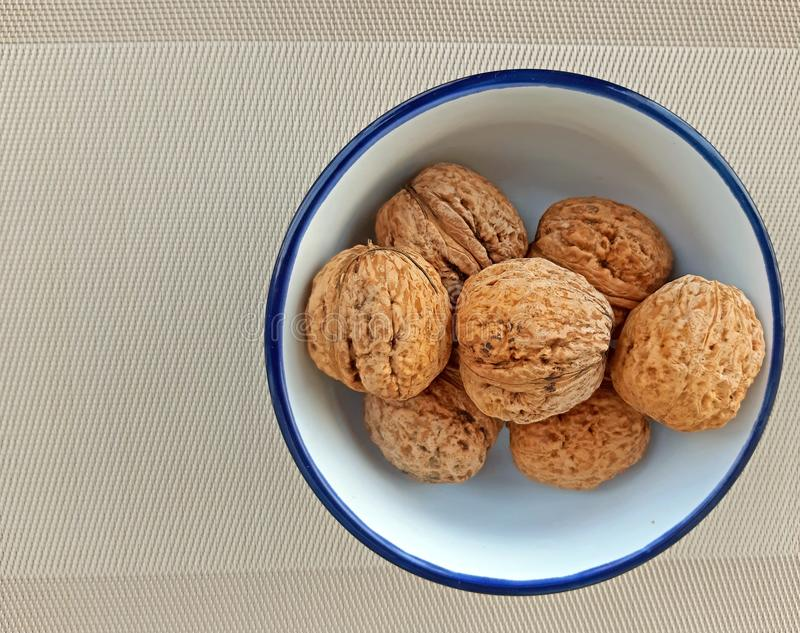 A plate of nuts on canvas background.  royalty free stock photos