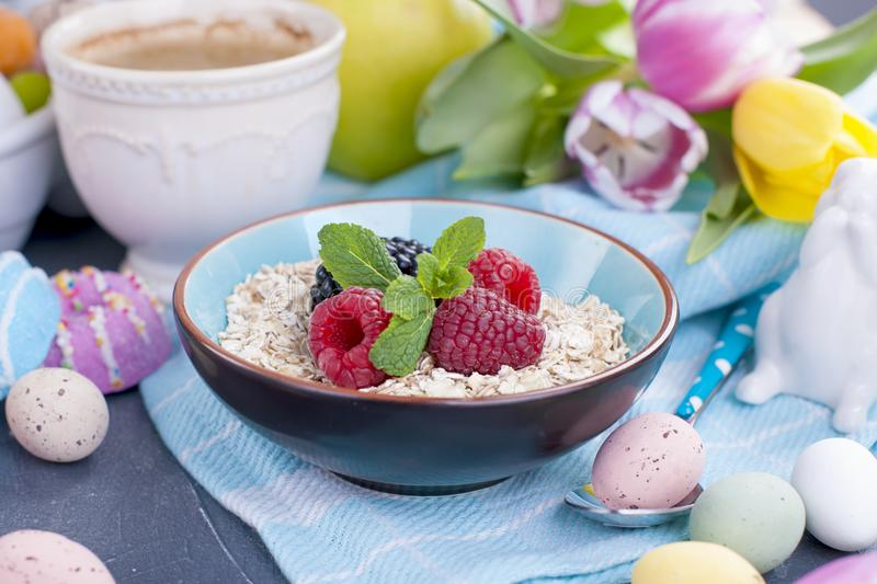 A plate of oatmeal with fresh raspberries and mint. Flavored coffee. A bouquet of spring tulips. A plate of oatmeal with fresh raspberries and mint. Flavored stock images